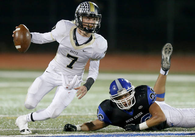 McAlester's Caden Pratt scrambles past Deer Creek's Jake Khoussine during a high school football playoff game at Deer Creek, Friday, Nov. 16, 2012. Photo by Bryan Terry, The Oklahoman