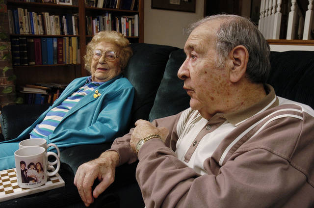 In this 2005 photo, Meyer Korenblit, also known as Majir  Kornblit, at right, with his wife, Manya, talks about his experiences in the Nazi death camps during the Holocaust.  <strong>Steve Sisney - THE OKLAHOMAN</strong>
