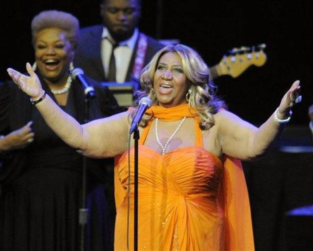 "FILE - This July 25, 2012 file photo shows Aretha Franklin performing at the NOKIA Theatre L.A. LIVE in Los Angeles. Franklin sang for Mrs. Obama and Holder _ as well as for about 3,000 fans at DAR Constitution Hall on Saturday, Nov. 17. Afterward, Franklin said it was great to see her VIP guests relax and ""shake their hips a little,"" especially after a tough reelection campaign.   (Photo by Chris Pizzello/Invision/AP, file)"