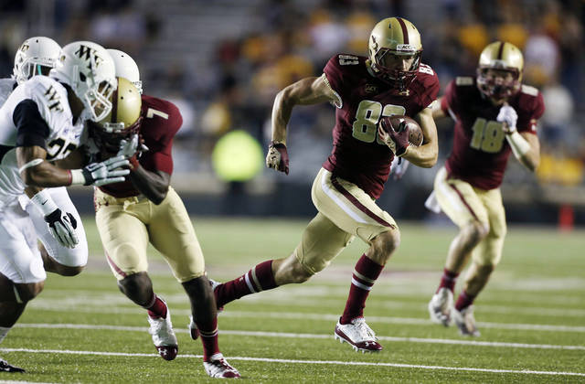 Boston College wide receiver Alex Amidon (83) carries the ball in the first quarter of an NCAA college football game against Wake Forest in Boston, Friday, Sept. 6, 2013. (AP Photo/Michael Dwyer)