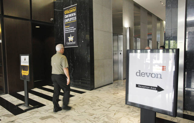 Opposing Continental Resources and Devon Energy signs in the lobby at 20 N Broadway in downtown Oklahoma City Monday, March 26, 2012. Photo by Paul B. Southerland, The Oklahoman