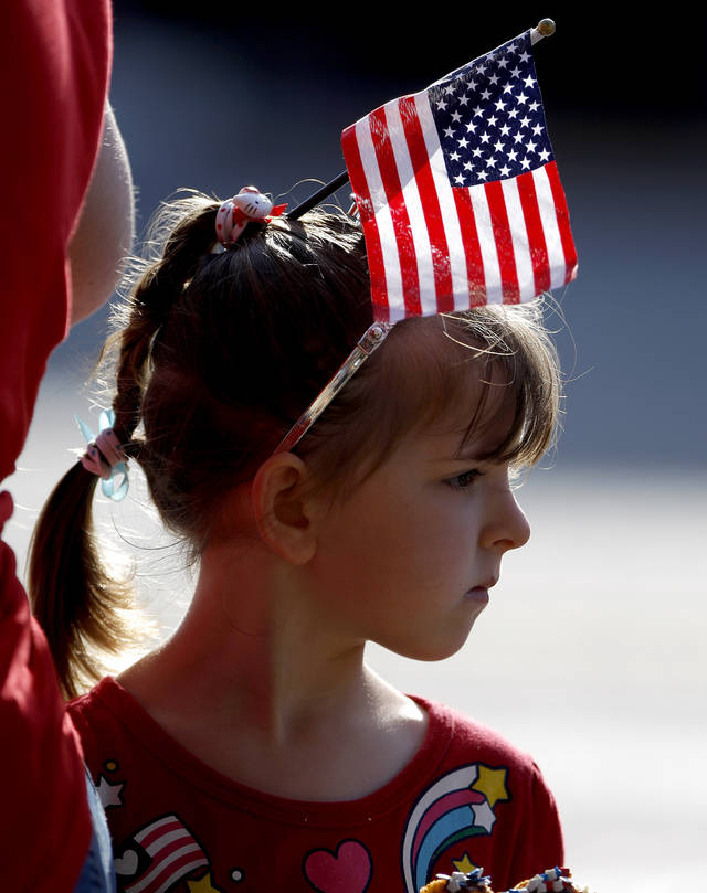 Kassidie Scroghem, 4, of Edmond watches the LibertyFest Fourth of July Parade in Edmond, Okla., Wednesday, July 4, 2012. Photo by Bryan Terry, The Oklahoman