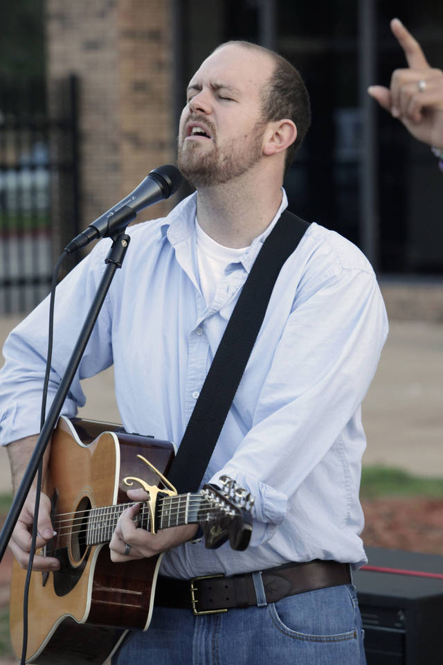 Jeremy Lea, math teacher and Christian Club sponsor, playing the guitar while singing during the annual See You at the Pole gathering at Putnam City North High School in Oklahoma City Wednesday, Sept. 22, 2010. Photo by Paul B. Southerland, The Oklahoman