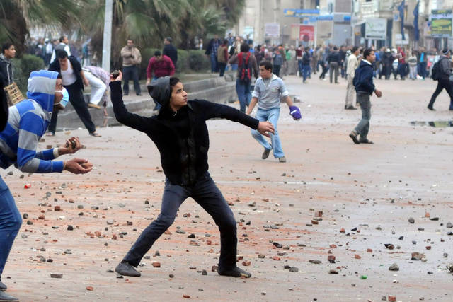 Opponents of Egyptian President Mohammed Morsi clash with Islamist supporters of the president, unseen in Alexandria, Egypt, Friday, Dec. 21, 2012. Thousands of Islamists clashed with their opponents Friday in Egypt&#039;s second largest city, Alexandria, on the eve of the second leg of voting on the country&#039;s contentious constitution that has deeply polarized the nation.(AP Photo)