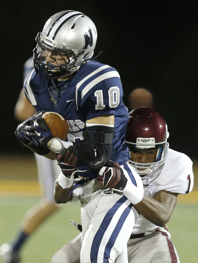 Edmond North's Chad Whiteley fights off Edmond Memorial's Ashton Antwine during a high school football playoff game at Wantland Stadium in Edmond, Okla., Thursday, Nov. 8, 2012. Photo by Bryan Terry, The Oklahoman
