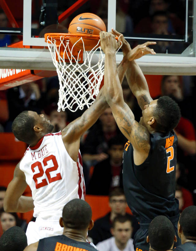 Cowboy's Le'Bryan Nash (2) scores guarded by Sooner's Amath M'Baye (22) during the second half as the University of Oklahoma Sooners (OU) defeat  the Oklahoma State Cowboys (OSU) 77-68  in NCAA, men's college basketball at The Lloyd Noble Center on Saturday, Jan. 12, 2013  in Norman, Okla. Photo by Steve Sisney, The Oklahoman