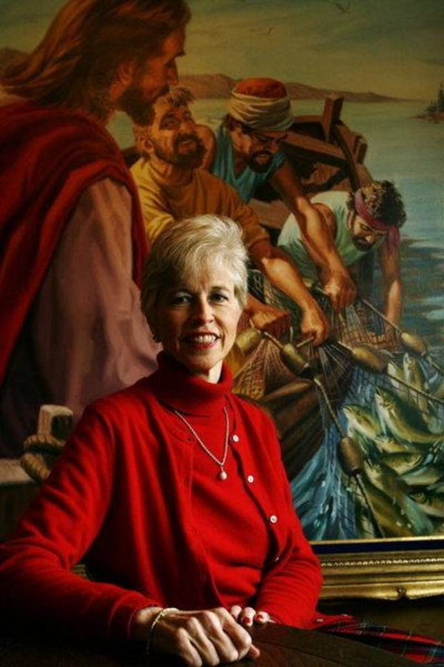 Roberta Potts sits in front of a painting formerly owned by her father, Oral Roberts, at her home in Tulsa on Wednesday. JAMES GIBBARD/Tulsa World