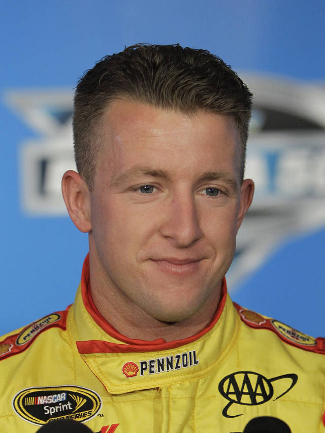 FILE - This Feb. 16, 2012 file photo shows A.J. Allmendinger during NASCAR media day at Daytona International Speedway in Daytona Beach, Fla. Penske Racing released Allmendinger on Wednesday, Aug. 1, 2012, three weeks after he tested positive for a banned amphetamine. The team said it was disappointed with the drug test results that left it with no choice. (AP Photo/John Raoux, File)