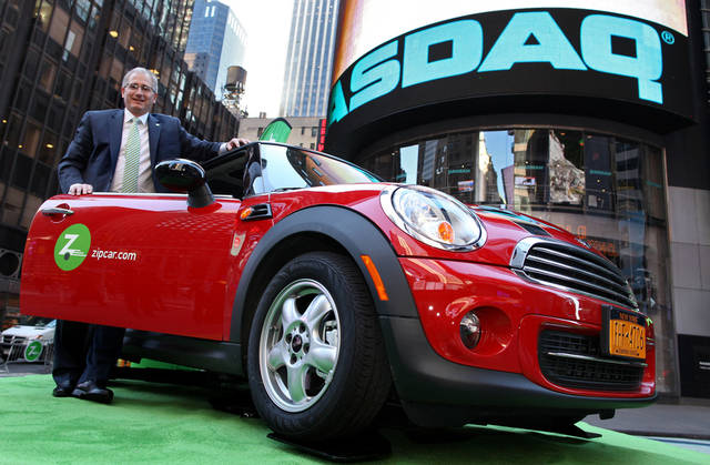Zipcar Chairman and CEO Scott Griffith stands with a Mini Cooper before the opening bell at the Nasdaq Market Site in New York. AP Photo