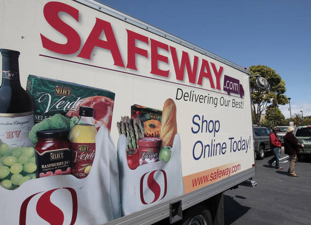FILE- In this Thursday, April 26, 2012, file photo, a Safeway online shopping advertisement is shown at a Safeway store in San Francisco. Grocery store operator Safeway said Thursday, Feb. 21, 2013, its customer loyalty program helped its fourth-quarter net income jump 13 percent in the fourth quarter, far surpassing expectations. (AP Photo/Paul Sakuma, File)