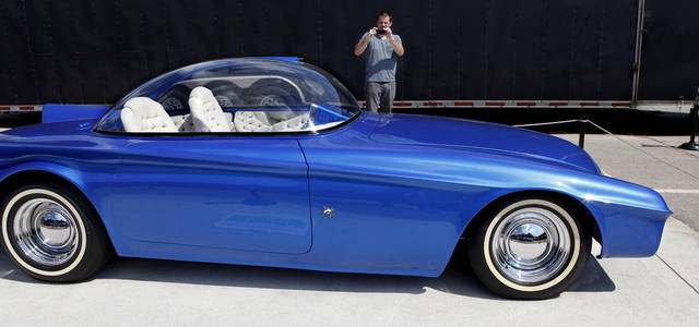 Joe Gitzendanner of Mustang, takes photos of one of Starbird's custom cars on display at the fair. Custom car builder and designer Darryl Starbird has brought a half-dozen of his cars from the National Rod & Custom Car Hall of Fame Museum to the Oklahoma State Fair. The museum is located in Afton.  This photo taken Monday, Sep. 17, 2012,  Photo by Jim Beckel, The Oklahoman.