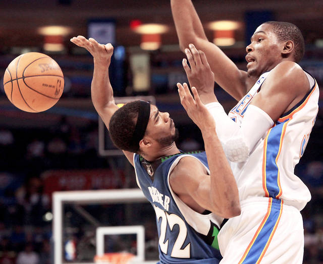 Thunder's Kevin Durant, right, has gotten to the free throw line in part because of being aggressive on the offensive end, like putting his rip move on Minnesota's Corey Brewer during this game on April 4.  Photo by John Clanton, The Oklahoman
