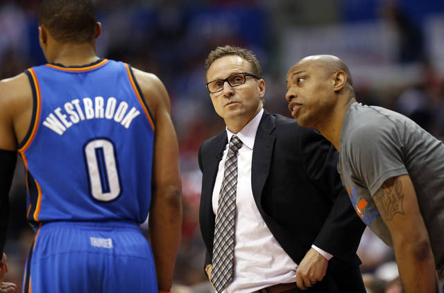 Oklahoma City's Caron Butler (2) talks to Russell Westbrook (0) near coach Scott Brooks during Game 4 of the Western Conference semifinals in the NBA playoffs between the Oklahoma City Thunder and the Los Angeles Clippers at the Staples Center in Los Angeles, Sunday, May 11, 2014. Photo by Nate Billings, The Oklahoman