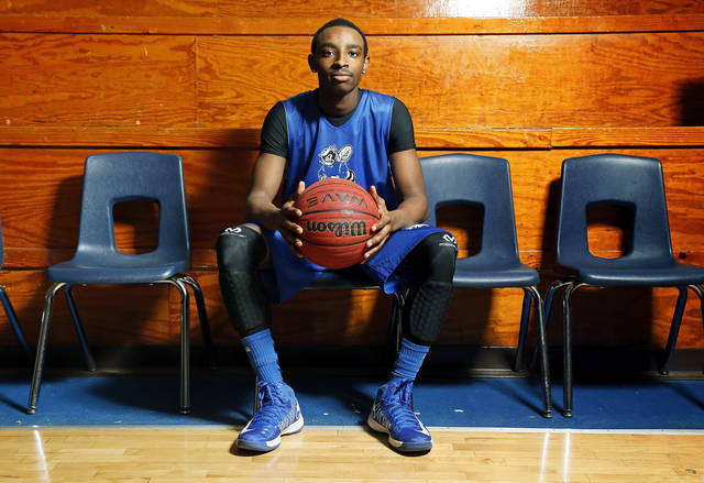 HIGH SCHOOL BASKETBALL: Coyle basketball player Eric Harris poses for a photo at Coyle High School in Coyle, Okla., Wednesday, Feb. 13, 2013. Harris lived in Chicago his entire life until moving with his father to Oklahoma and starting school at Coyle last December. Photo by Nate Billings, The Oklahoman