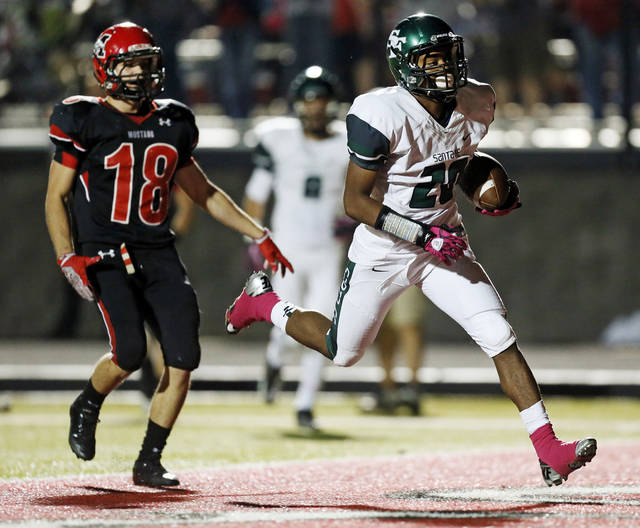 Edmond Santa Fe's Cameron Westbrook (20) scores a touchdown in front of Mustang's Sean Summers (18) during a high school football game between Mustang and Edmond Santa Fe in Mustang, Okla., Friday, Sept. 28, 2012. Photo by Nate Billings, The Oklahoman
