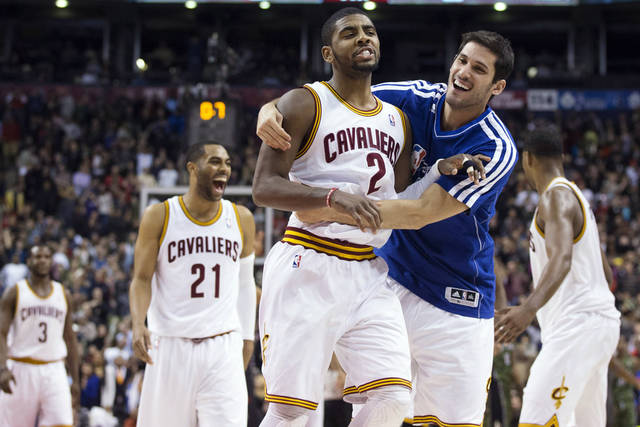 Cleveland Cavaliers' Kyrie Irving (2) is congratulated by Omri Casspi after hitting a 3-pointer against the Toronto Raptors with 0.7 seconds left in the second half of an NBA basketball game, Saturday, Jan. 26, 2013, in Toronto. The Cavaliers won 99-98. (AP Photo/The Canadian Press, Chris Young) ORG XMIT: CHY127