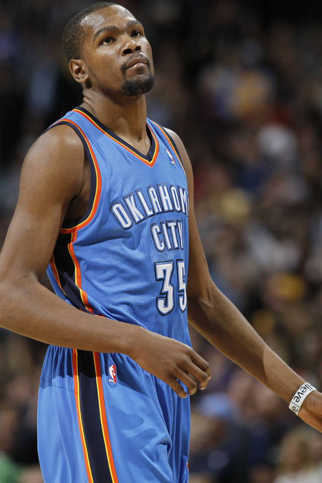 Oklahoma City Thunder forward Kevin Durant reacts as time expires in overtime of an NBA basketball game against the Denver Nuggets in Denver on Sunday, Jan. 20, 2013. The Nuggets won 121-118 in overtime. (AP Photo/David Zalubowski)