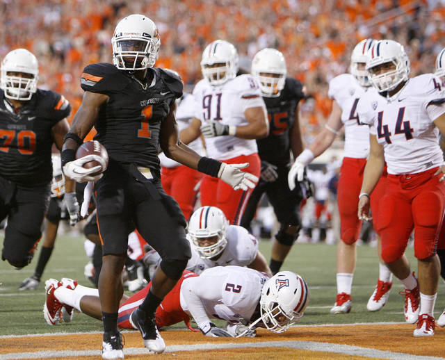 Oklahoma State's Joseph Randle (1) scores a touchdown during a college football game between the Oklahoma State University Cowboys (OSU) and the University of Arizona Wildcats at Boone Pickens Stadium in Stillwater, Okla., Thursday, Sept. 8, 2011. Photo by Bryan Terry, The Oklahoman  ORG XMIT: KOD
