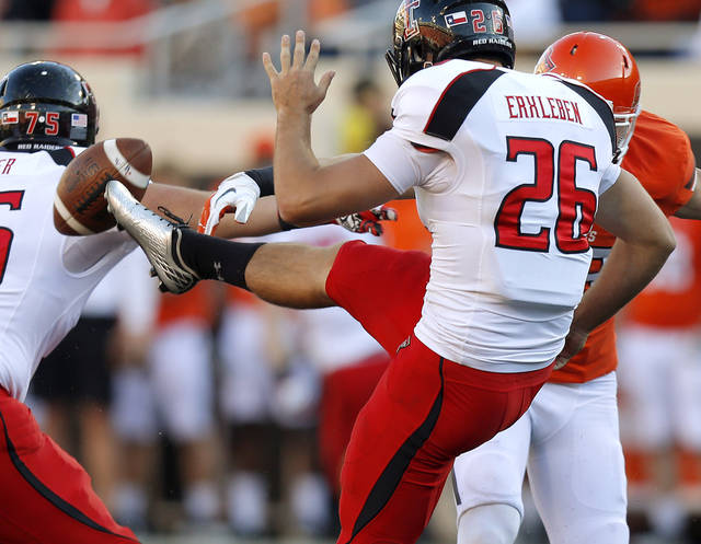 Texas Tech's Ryan Erxleben (26) has his punt blocked by Oklahoma State's Zack Craig (23) during a college football game between Oklahoma State University (OSU) and Texas Tech University (TTU) at Boone Pickens Stadium in Stillwater, Okla., Saturday, Nov. 17, 2012.  Photo by Bryan Terry, The Oklahoman