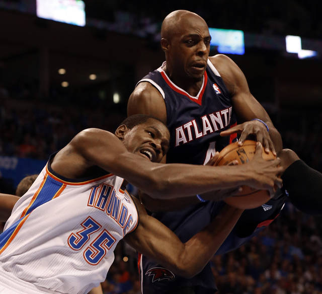 Oklahoma City Thunder's Kevin Durant (35) and Atlanta Hawk's Anthony Tolliver (4) fight for a rebound as the Oklahoma City Thunder play the Atlanta Hawks in NBA basketball at the Chesapeake Energy Arena in Oklahoma City, on Sunday, Nov. 4, 2012.  Photo by Steve Sisney, The Oklahoman