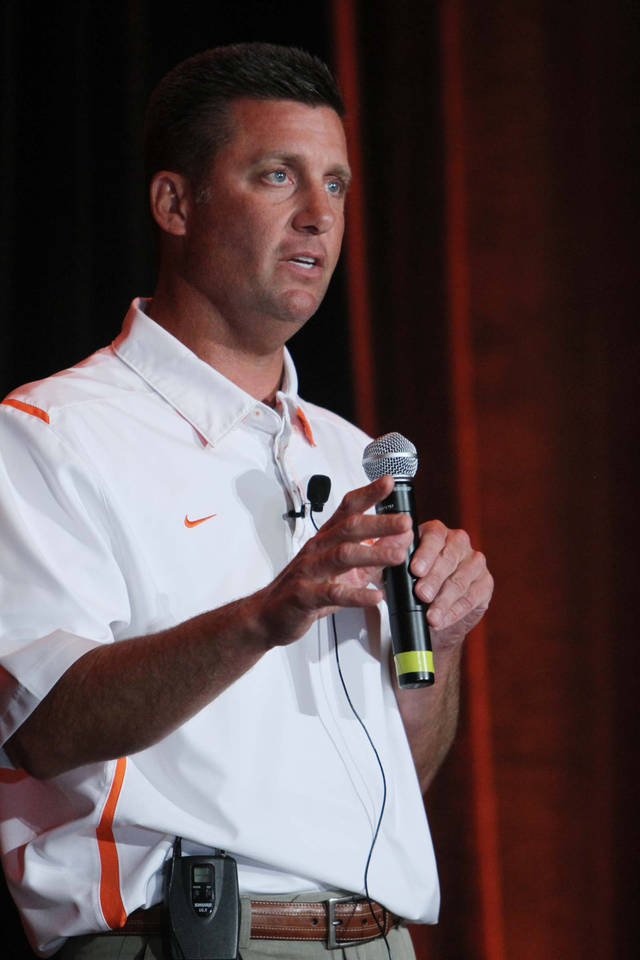 OSU football head coach Mike Gundy speaks to a crowd at the OSU caravan at the Renaissance Hotel in Tulsa, Okla. taken on August 1,2012. JAMES GIBBARD/Tulsa World
