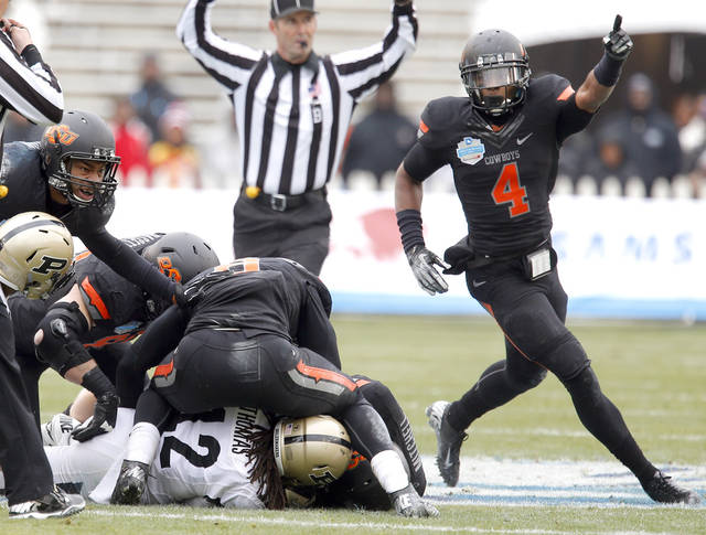 Oklahoma State's Justin Gilbert (4) celebrates a fumble recovery during the Heart of Dallas Bowl football game between the Oklahoma State University (OSU) and Purdue University at the Cotton Bowl in Dallas,  Tuesday,Jan. 1, 2013. Photo by Sarah Phipps, The Oklahoman