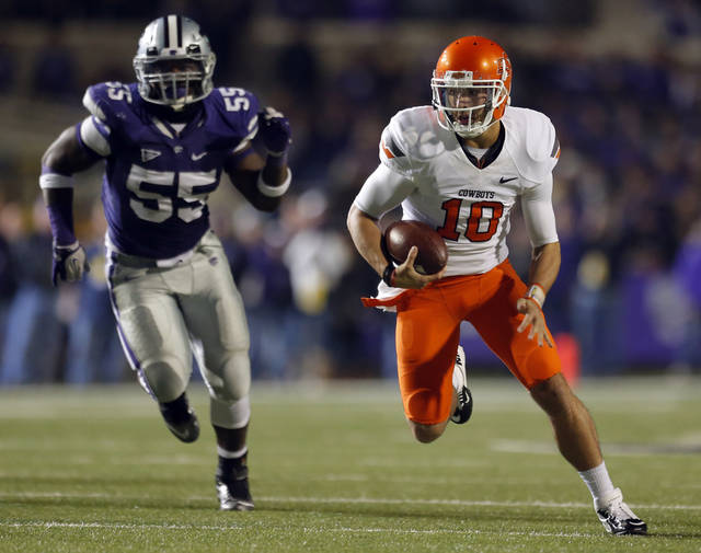 Oklahoma State's Clint Chelf (10) scrambles as Kansas State's Adam Davis (55) chases him down during the college football game between Kansas State University (KSU) and Oklahoma State (OSU) at  Bill Snyder Family Football Stadium in Manhattan, Kan.,  Saturday, Nov. 3, 2012. Photo by Sarah Phipps, The Oklahoman