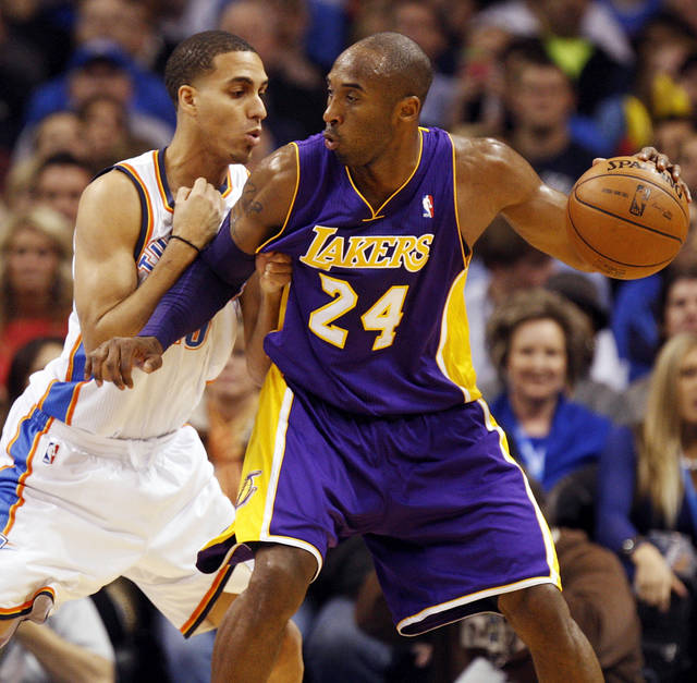 Los Angeles' Kobe Bryant (24) works against Oklahoma City's Kevin Martin (23) during an NBA basketball game between the Oklahoma City Thunder and the Los Angeles Lakers at Chesapeake Energy Arena in Oklahoma City, Friday, Dec. 7, 2012. Photo by Nate Billings, The Oklahoman