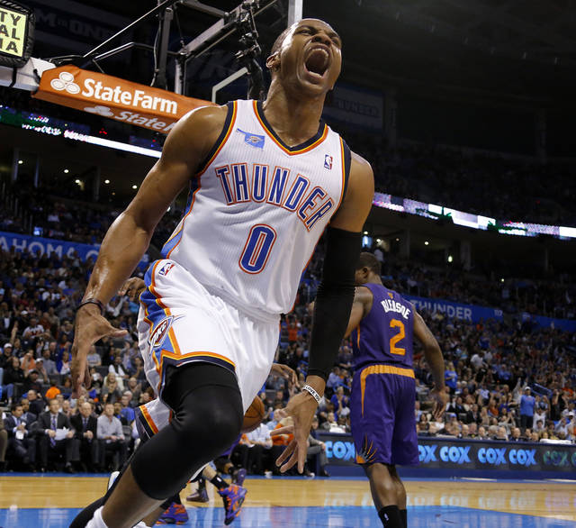 Oklahoma City Thunder point guard Russell Westbrook (0) celebrates during an NBA basketball game between the Oklahoma City Thunder and the Phoenix Suns at Chesapeake Energy Arena in Oklahoma City, Sunday, Nov. 3, 2013. Oklahoma City won 103-96. Photo by Bryan Terry, The Oklahoman