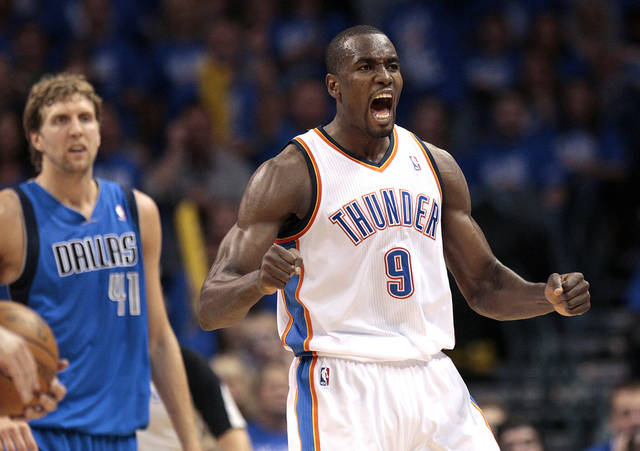 Oklahoma City's Serge Ibaka (9) celebrates after a offensive foul on Dallas' Dirk Nowitzki (41) during game one of the first round in the NBA playoffs between the Oklahoma City Thunder and the Dallas Mavericks at Chesapeake Energy Arena in Oklahoma City, Saturday, April 28, 2012. Photo by Sarah Phipps, The Oklahoman