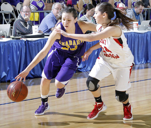 Anadarko's Lakota Beatty, left, shown here driving past Ft. Gibson's Jodi Glover last March during the Class 4A girls basketball state tournament, signed with Oklahoma State's women's basketball program on Wednesday. Photo by Chris Landsberger, The Oklahoman <strong>CHRIS LANDSBERGER - CHRIS LANDSBERGER</strong>