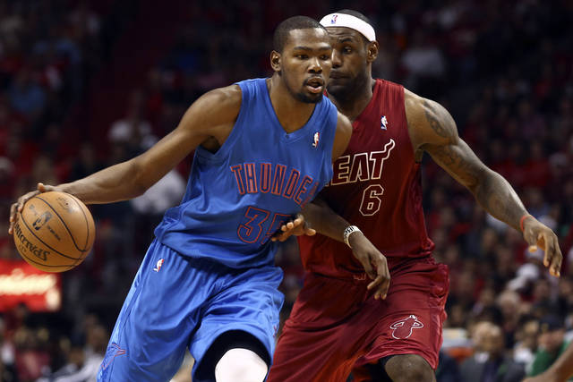 Oklahoma City Thunder's Kevin Durant (35) drives against Miami Heat's LeBron James during the second half of an NBA basketball game in Miami, Tuesday, Dec. 25, 2012. The Heat won 103-97. (AP Photo/J Pat Carter) ORG XMIT: FLJC114