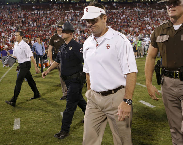 Oklahoma coach Bob Stoops walks off the field after a college football game between the University of Oklahoma Sooners (OU) and the Kansas State University Wildcats (KSU) at Gaylord Family-Oklahoma Memorial Stadium, Saturday, September 22, 2012. Oklahoma lost 24-19. Photo by Bryan Terry, The Oklahoman