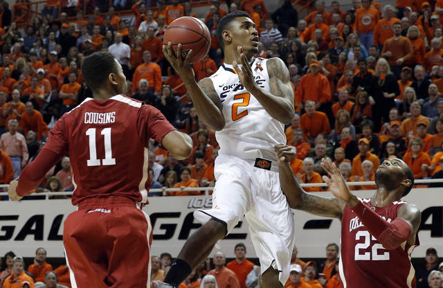 Oklahoma State's Le'Bryan Nash (2) shoots a lay up in between Oklahoma's Isaiah Cousins (11) and Oklahoma's Amath M'Baye (22) during the Bedlam men's college basketball game between the Oklahoma State University Cowboys and the University of Oklahoma Sooners at Gallagher-Iba Arena in Stillwater, Okla., Saturday, Feb. 16, 2013. Photo by Sarah Phipps, The Oklahoman