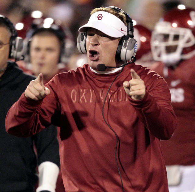 Defensive coordinator Mike Stoops wants a grounding call against Notre Dame quarterback Everett Golson (5) during the first half of the college football game between the University of Oklahoma Sooners (OU) and the Fighting Irish of Notre Dame (ND) at Gaylord Family-Oklahoma Memorial Stadium in Norman, Okla., on Saturday, Oct. 27, 2012. Photo by Steve Sisney, The Oklahoman
