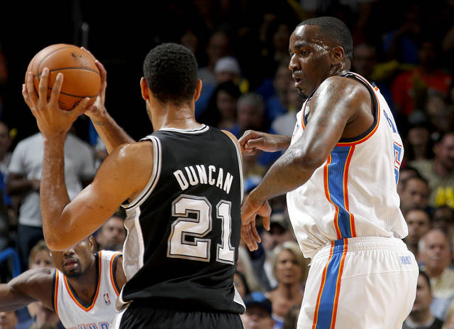 Oklahoma City's Kendrick Perkins (5) defends San Antonio's Tim Duncan (21) during an NBA basketball game between the Oklahoma City Thunder and the San Antonio Spurs at Chesapeake Energy Arena in Oklahoma City, Thursday, April 3, 2014. Photo by Bryan Terry, The Oklahoman