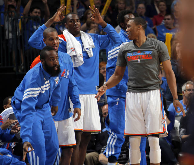 Oklahoma City's James Harden (13), Eric Maynor (6), Serge Ibaka (9) and Russell Westbrook (0) celebrate a three-pointer during the preseason NBA game between the Oklahoma City Thunder and the Charlotte Bobcats at Chesapeake Energy Arena in Oklahoma City, Tuesday, Oct. 16, 2012. Photo by Sarah Phipps, The Oklahoman