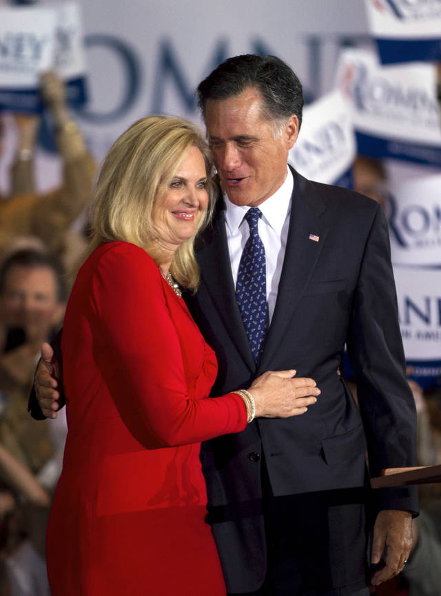 "FILE - In this March 20, 2012 file photo, Republican presidential candidate, former Massachusetts Gov. Mitt Romney, and his wife Ann hug during a victory rally in Schaumburg, Ill. Ann Romney is firing back at a Democratic consultant who is suggesting that the wife of wealthy presidential candidate Mitt shouldn�t be talking about the economy�s toll on women. ""Guess what, his wife has actually never worked a day in her life,"" said consultant Hilary Rosen on CNN. The remark inspired Ann Romney�s debut on Twitter. (AP Photo/Steven Senne)"