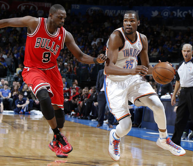 Oklahoma City's Kevin Durant (35) tries to get past Chicago's Luol Deng (9) during the NBA game between the Oklahoma City Thunder and the Chicago Bulls at Chesapeake Energy Arena in Oklahoma City, Saturday, Feb. 23, 2013. Photo by Sarah Phipps, The Oklahoman