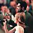Thunder assistant coach Maurice Cheeks gave Natalie Gilbert a little help singing the national anthem when he was coaching the Portland Trail Blazers in 2003. PHOTO BY BRUCE ELY, THE OREGONIAN