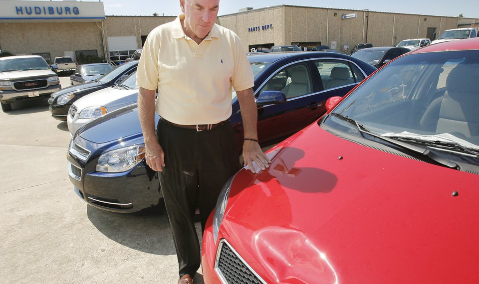 Related Photos STORM DAMAGE: Steve Blake Looks Over Some Hail Damage At Hudiburg  Chevy/GMC In