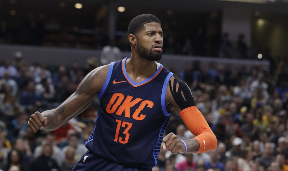 fdc93d0f2594 Oklahoma City Thunder s Paul George reacts after a dunk during the first  half of an NBA