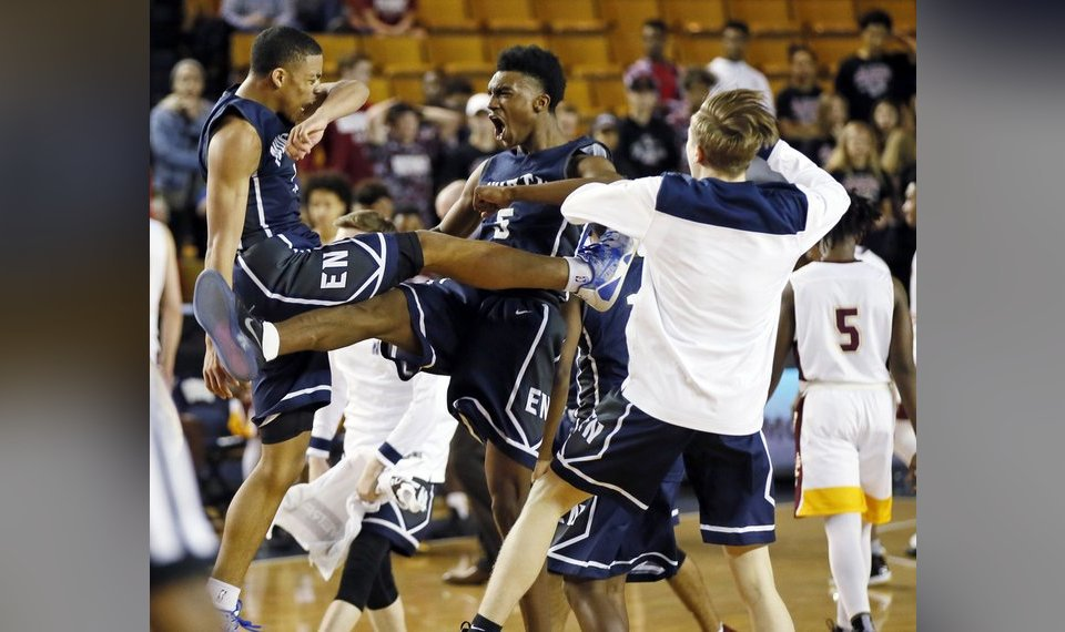 edmond norths jakaree holmes left and marvin johnson celebrate during a timeout late in