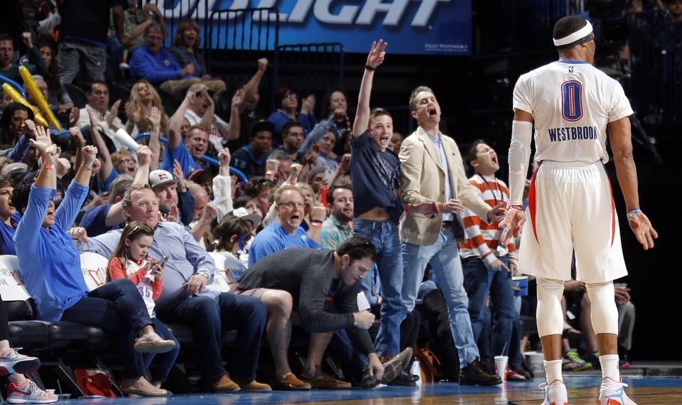 9456d7a0bba0 Fans celebrates after Oklahoma City s Russell Westbrook (0) makes a 3-point  basket
