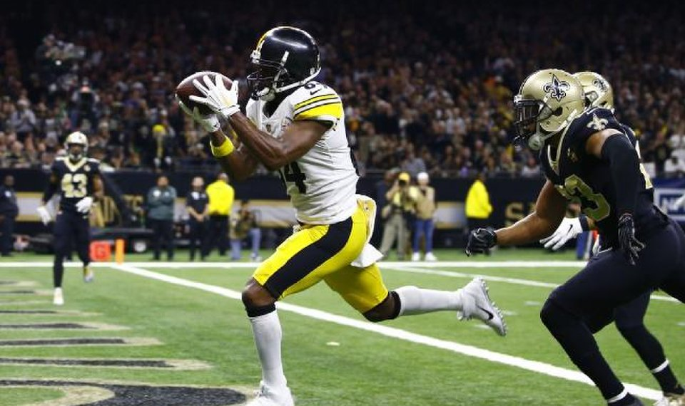5201a935135 Steelers wide receiver Antonio Brown caught 104 passes for 1,297 yards and  15 touchdowns in 2018