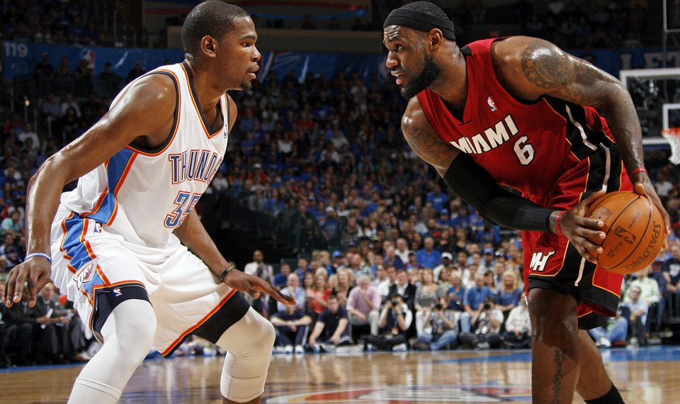 93250e2b6 Miami s LeBron James (6) looks to get the ball past Oklahoma City s Kevin  Durant