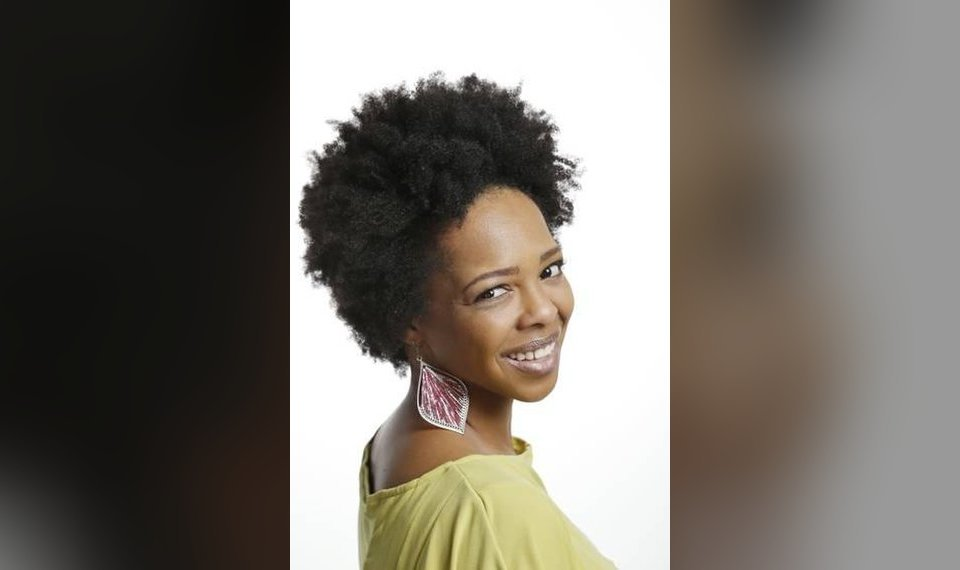 Women of color embracing natural hair styles