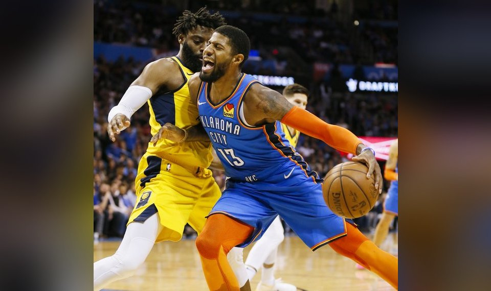 d15c3e33aa7c Related Photos Oklahoma City s Paul George (13) tries to take the ball past  Indiana s Tyreke Evans