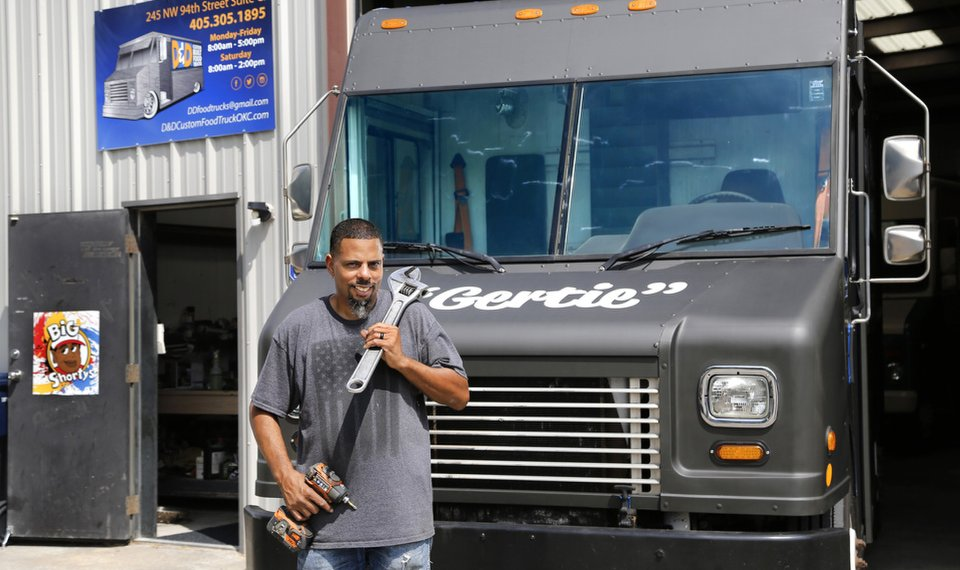 D Custom Built Food Trucks Owner Deion Estrada Stands In Front Of His And One