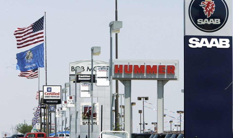 Saab, Hummer And Saturn Signs Are Seen At The Bob Moore Autoplex On  Broadway Extension